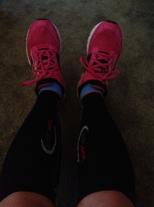 Pink and green shoes, blue socks, black compression sleeves. Not pictured: blue and gold Cal running shorts