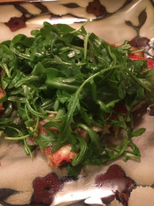Delicious cheese pizza with fresh arugula on top